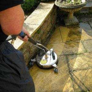 Patio edge cleaning action shot